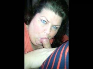 Fat brunette sucking his cock