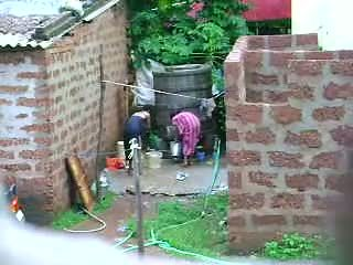 Watch this two hot sri lankan lady getting bath in ruangan