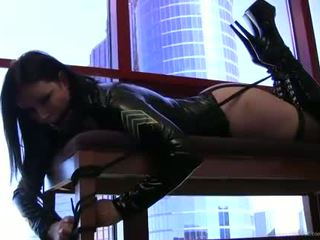 Emily Addison on couch gagging with black ball