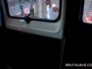Topless brunette plays with dick in the sex bus