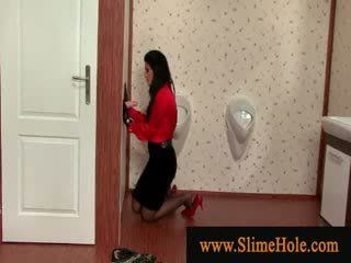 Nasty lady in red wearing handgloves gets slimed