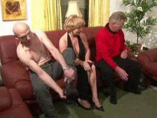 Granny plays with two cocks Video