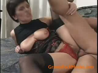Hairy granny with firm Melons