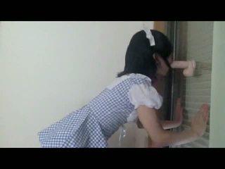Blindfolded Japanese CD gags on dildo