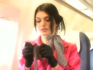 Beautiful stewardess sucking a hard penis