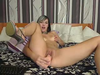 Czech girl using a huge dildo Video