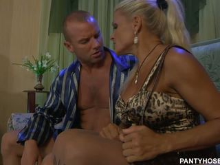 Tanned blonde milf in pantyhose gets slammed doggy style