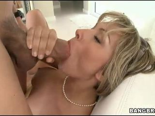 Sucking a gigantic male rod